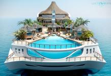 Das Hauptdeck ist wie privater Strand entworfen mit einem Swimming-Pool, der von Palmen und kleinen Hütten umgeben ist.